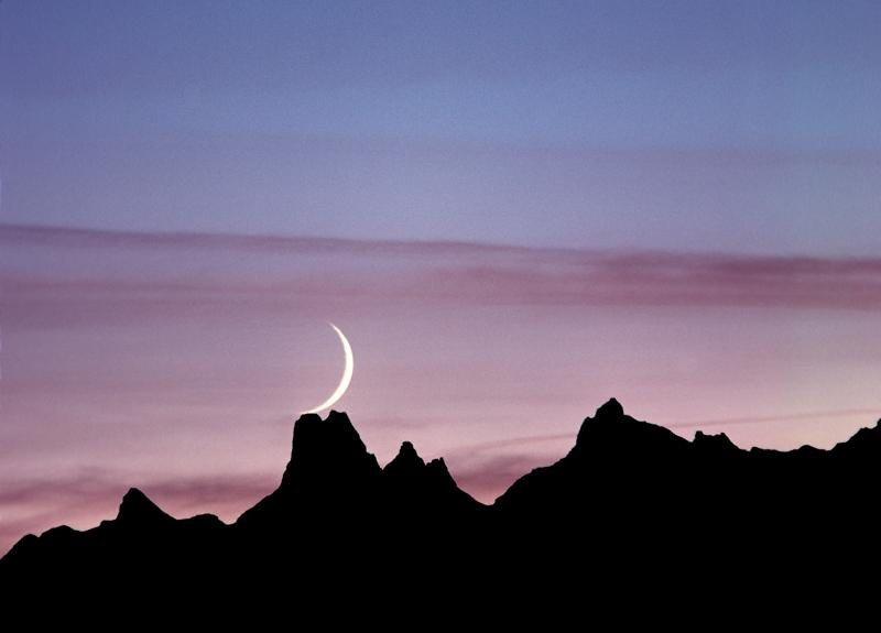 New Moon over mountains